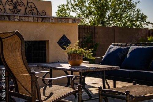 A travertine tile pool deck with plants and lounge chairs in the Arizona southwest Canvas Print