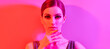 canvas print picture - High Fashion. Model in colorful neon light, make-up. Sexy girl, stylish hair, trendy makeup. Party neon pink purple style. Glamour beauty Woman face, fashionable portrait, bright make up