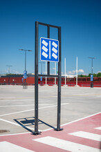 An Empty Car Parking Lot With European Style Traffic Sign.