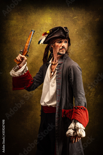 Portrait of a pirate, holding a musket gun in his hand Canvas Print