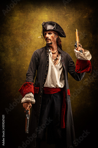 Portrait of a pirate, holding two musket pistol in his hands Wallpaper Mural
