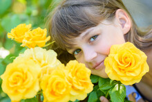 Portrait Of A Girl Of Nine Years With Yellow Roses