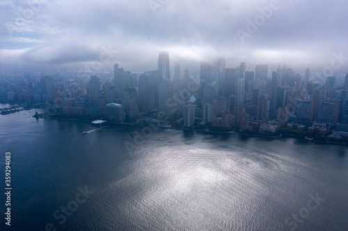 Aerial view of New York City skyline with cloud and downtown Manhattan