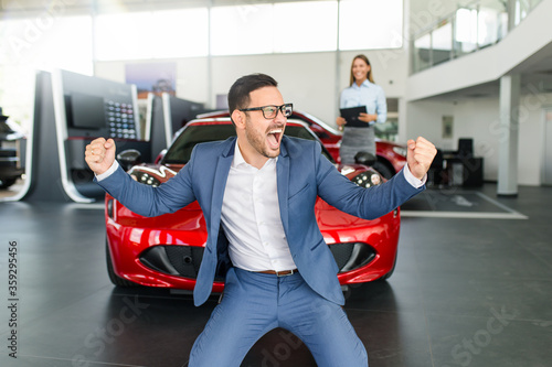 Obraz na plátně Excited man happy because of buying a new car.