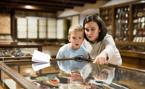 Woman and boy exploring artworks in museum Canvas Print