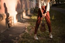 Girl With Ukulele On The Street