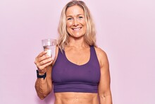 Middle Age Caucasian Blonde Woman Drinking Glass Of Water Looking Positive And Happy Standing And Smiling With A Confident Smile Showing Teeth