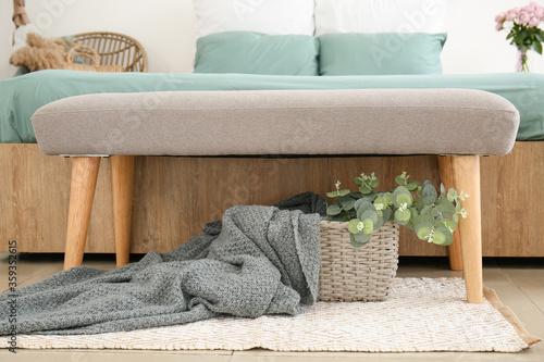 Fototapeta Big bed and bench in interior of modern room obraz na płótnie