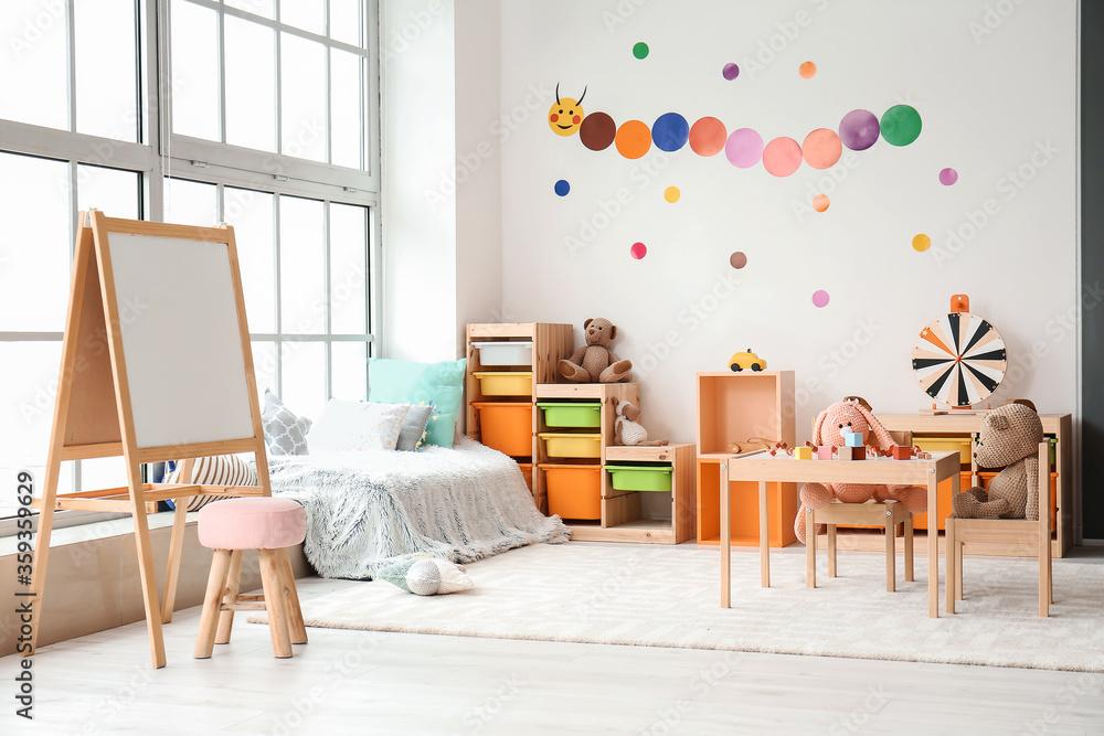 Fototapeta Stylish interior of modern playroom in kindergarten
