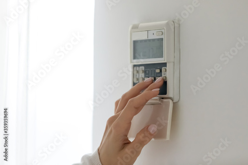 Fényképezés Wall-mounted digital climate control home thermostat controlling, smart contemporary and modern house concept