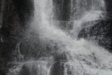 Water Flowing From The Waterfall