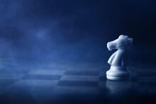 White Chess Knight On Chess Bo...