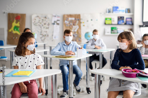 Children with face mask back at school after covid-19 quarantine and lockdown. - 359436002