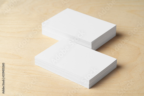 Two piles of blank business cards on table Canvas Print
