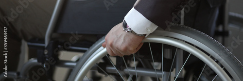 Close-up of disabled man on wheelchair in office wearing presentable suit Canvas Print