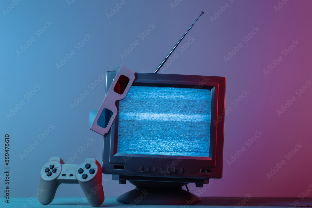Antenna old-fashioned  tv receiver with anaglyph stereo glasses, gamepad in pink blue gradient neon light. Retro media, entertainment 80s, retro wave