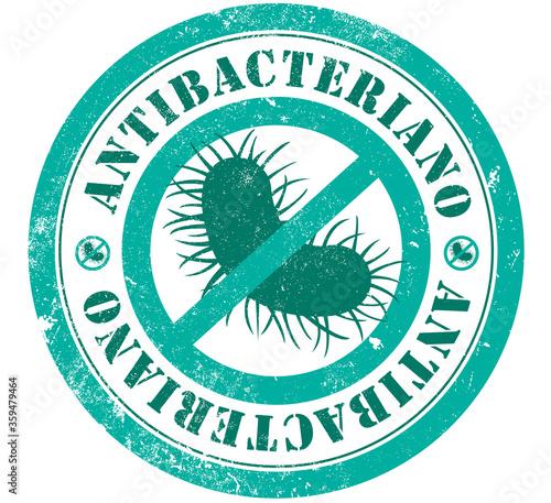 Foto Antibacterial grunge stamp in spanish language
