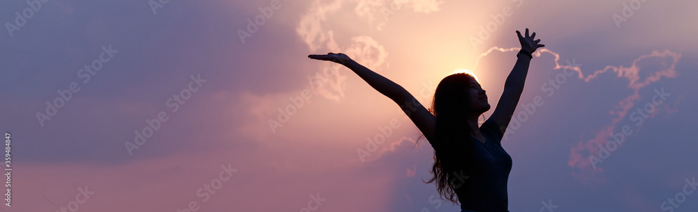 Fototapeta Happy confident Asian woman raising her hands up relax on summer vacation time, carefree girl being in nature, freedom people.