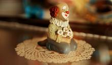 A Clown Trinket On Lace