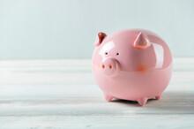 Pink Piggy Bank On White Wood ...