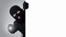 Masked Villain Peeking Out White Blank Board At Studio