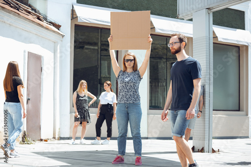 Dude with sign - woman stands protesting things that annoy her Canvas Print
