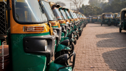 Indian taxi rickshaws exposed in a row. Canvas-taulu