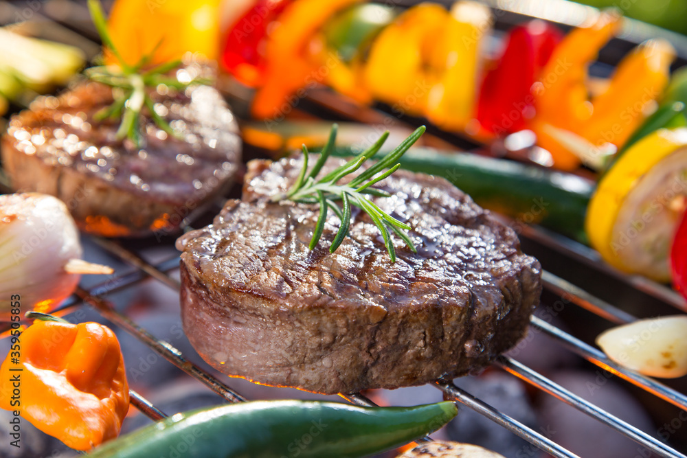 Fototapeta Barbecue garden grill with beef steaks, close-up.