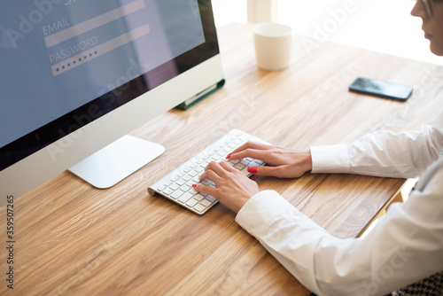 Fototapeta Shot of unrecognizable businesswoman typing on computer's keyboard obraz