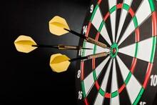 Closeup Of Darts In Bullseye