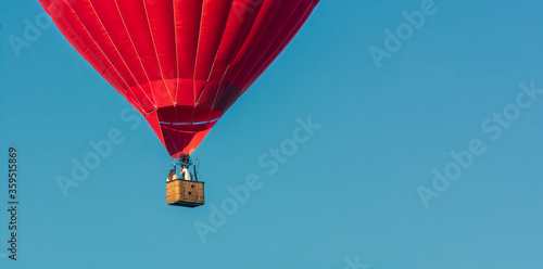Red balloon in the sky Canvas Print