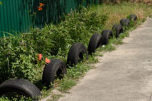 Fence Of Car Tires In The Garden