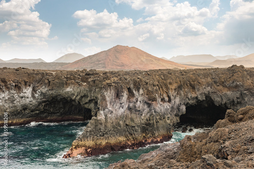 Los Hervideros lava caves in Lanzarote island, popular touristic attraction, Canary islands, Spain
