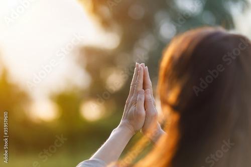 Valokuvatapetti A woman prays .