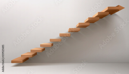 Foto Empty room with brown staircase and arrow sign instead of top step