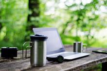 Computer Coffee Mug And Telephone On Black Wood Table.