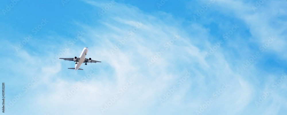 Fototapeta Panoramic Background with flying plane in blue sky