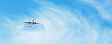 Panoramic Background With Flying Plane In Blue Sky