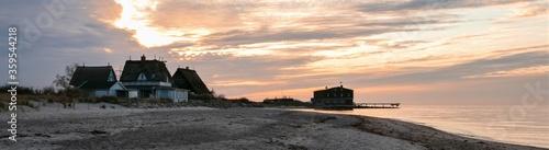 Fototapeta beach cottages by the sea, panorama obraz