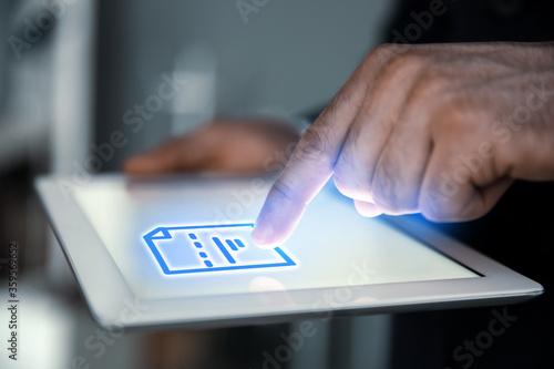 Fototapeta Man clicking on document icon using tablet, closeup obraz