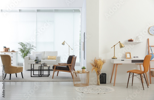 Fototapeta Living room and workplace in spacious apartment. Interior design obraz