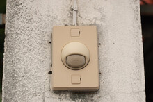 Doorbell On The Old Concret Wall