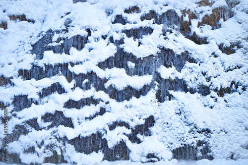 Icy waterfall on a mountain river. Canvas Print