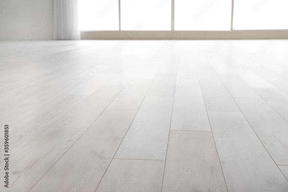 Fototapeta View of clean laminate floor in empty room