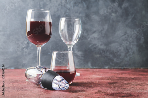Aerator and glasses of wine on table Canvas Print