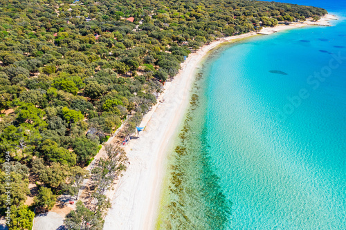 Croatia, beautiful island of Pag, long beaches under pine trees, turquoise water of Adriatic Sea on sunny summer day Wallpaper Mural