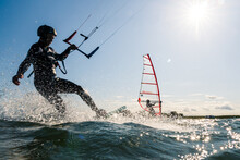 Kitesurfer And Windsurfer Havi...