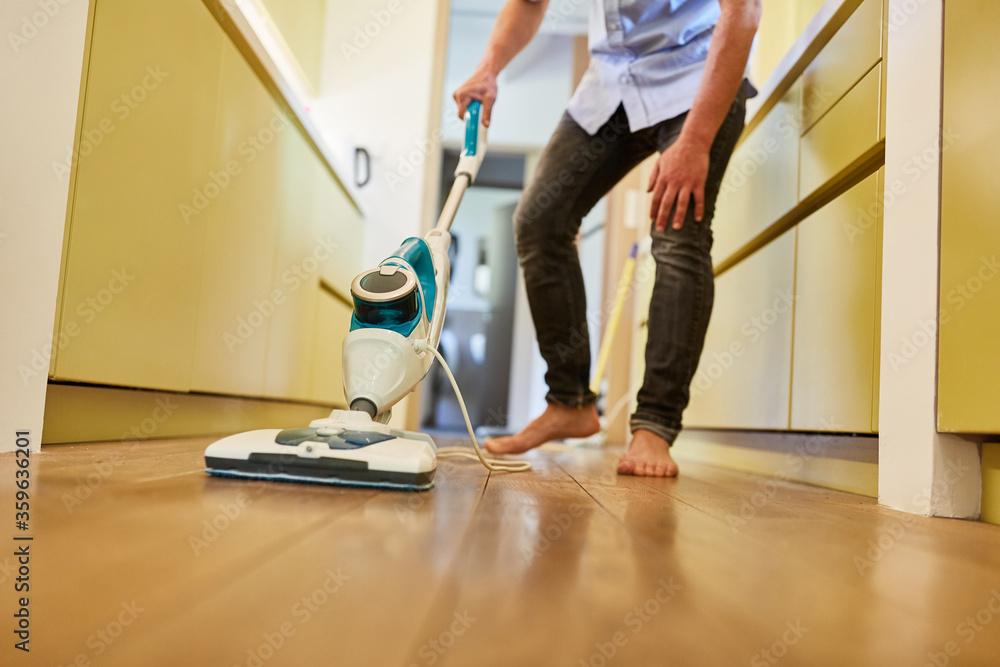 Fototapeta Steam cleaner for floor cleaning in the hallway