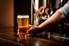 Bartender Holding Light Beer O...