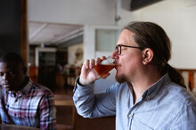 Caucasian Man Tasting Beer In ...